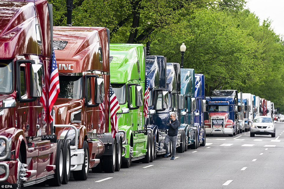 Truckers protest against low freight rates outside the White House while heavily armed men surround the New Hampshire and Oregon capitols as anti-lockdown demonstrations continue